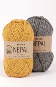 Gult og grått Drops Nepal garnnøster.