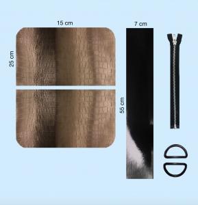 To skinnrektangler, en veskestropp, en glidelås og to ringer til å sy veske av.