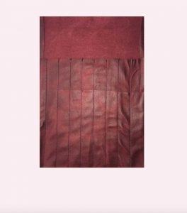 Skinnetui med lommer til strikkepinner.