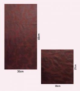 To rektangler i brunt skinn i ulik størrelse.
