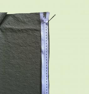 glidelås plassering mellom to firkanter i linstoff.